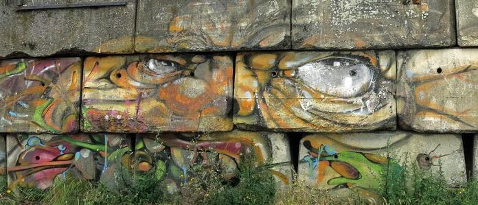 Graffiti Street Art at NDSM werf Amsterdam - Mr Melted Face