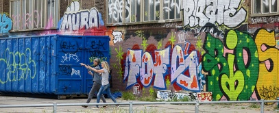 NDSM graffiti and tagging Amsterdam - two women walk talk and point to the future
