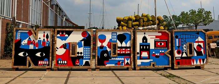 NOORD spelled out in street art brick blocks at NDSM Amsterdam