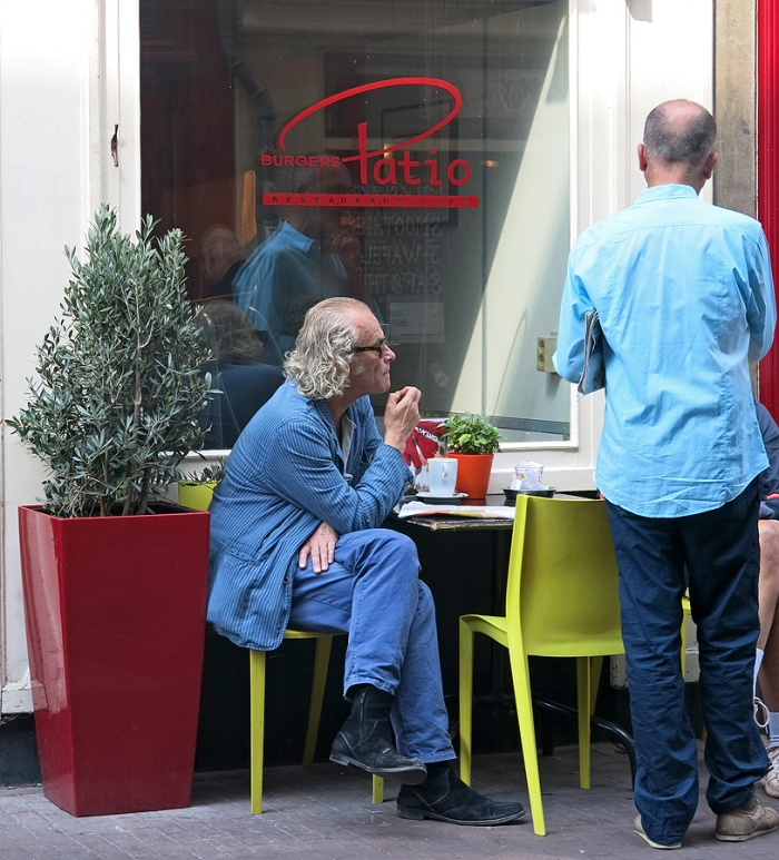 Photograph of street scene outside Cafe Tuin Jordaan District Amsterdam - an interesting local