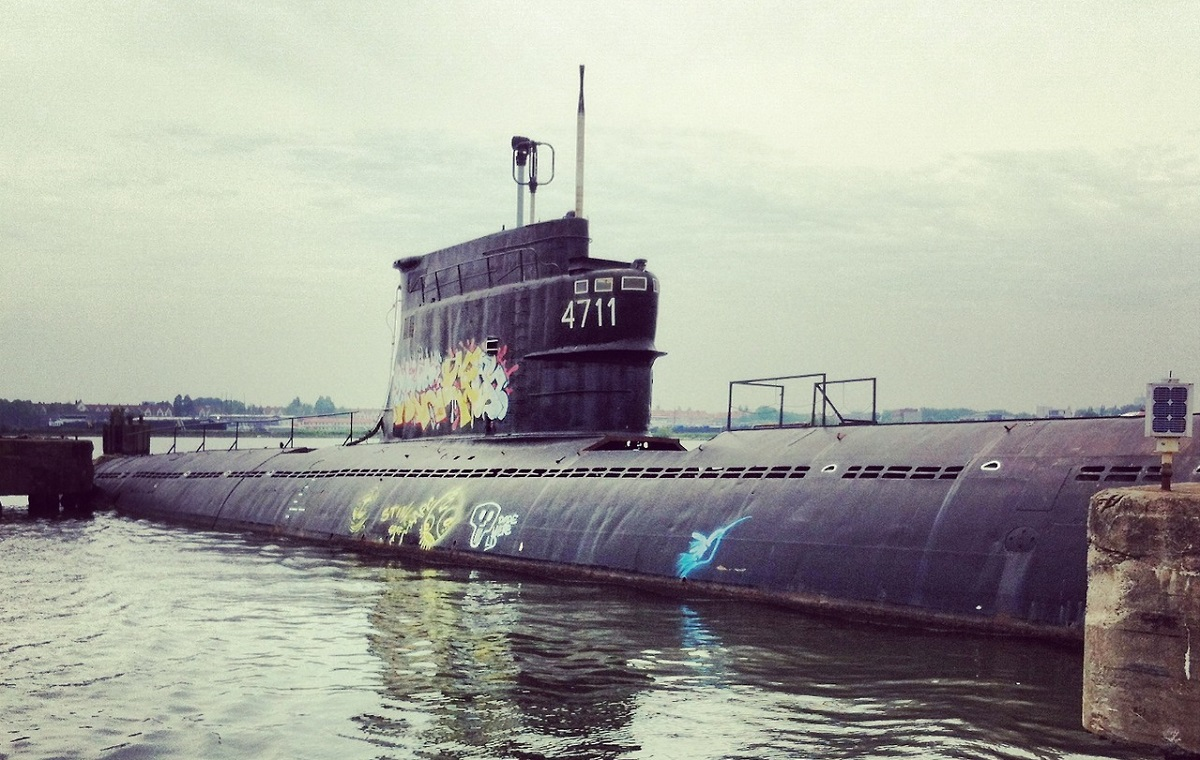submarine left abandoned to rust at NDSM Wharf Amsterdam - with grafitti
