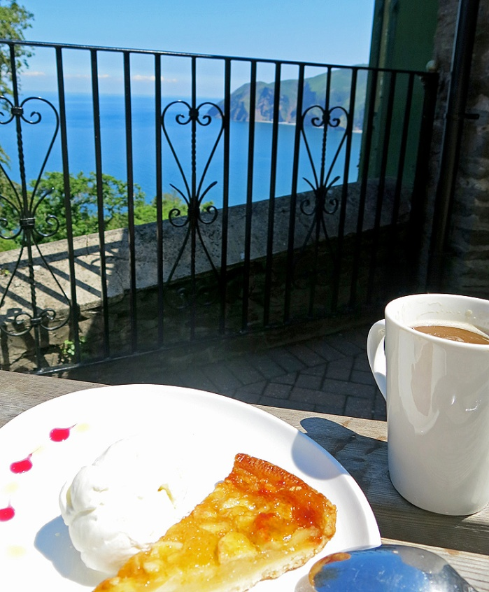 Cliff Top Cafe Lynton Devon a slice of the best home-baked apple tart glazed with orange in the world - served with devon ice cream