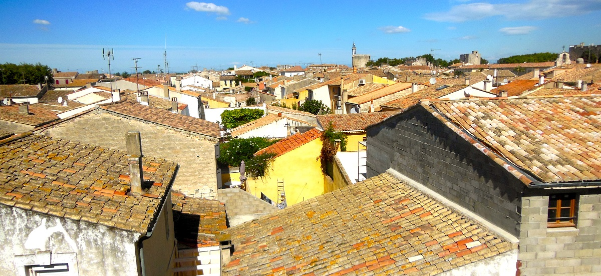 Clutter of rooftops of houses in Aigues-Mortes - a village inside a medieval wall