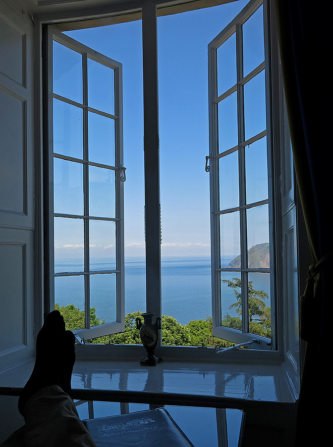 Enjoying the sea view, sitting on chaise-lounge,  feet on coffee table Bay View Suite Lynton Cottage hotel - Devon England