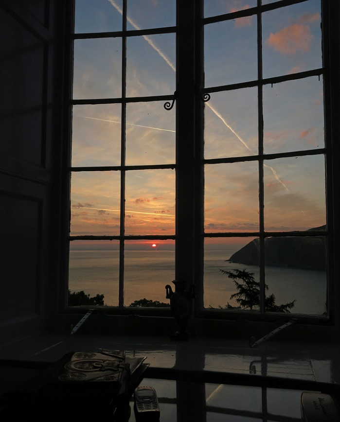 Good morning world - watching the sun rise above the horizon from Bay View Suite at Lynton Cottage