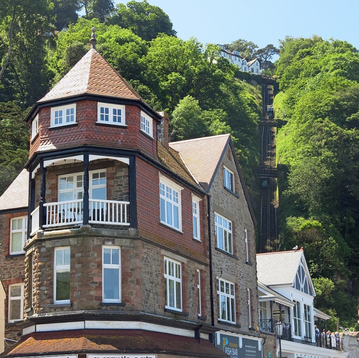 Interesting English architecture Lynmouth with view of funicular heading up to Cliff Top Cafe