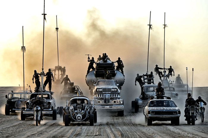 Mad Max Fury Road desert scene with road warriors and post-apocalyptic vehicles