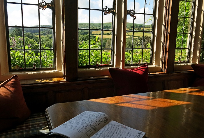 The view from library of Bovey Castle - looking out across the Moors with Santiago notebook of David J Rodger in foreground