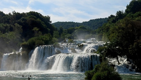 Krka National Park - Croatia Travel David J Rodger swimming with locals and tourists at base of falls