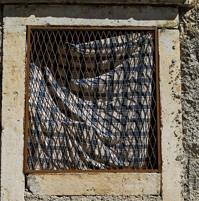 Skradin - Croatia Travel Photo by David J Rodger - table cloth over window and chicken wire
