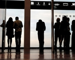 The Hunger - photograph of figures silhouetted in observation window at London Shard by David J Rodger