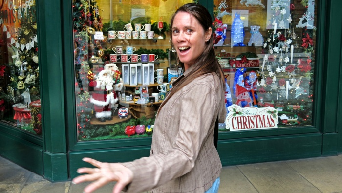 white girl in early 40s delighted by the existence of a Christmas shop - very Dickens image