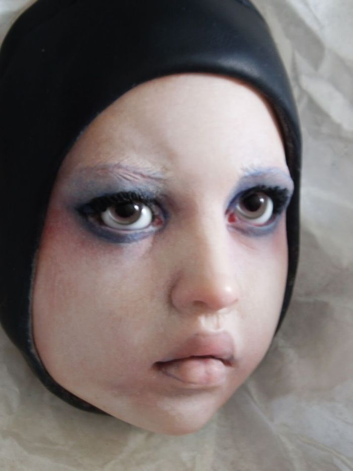 baby harlequin eerie sinister doll face by Nita Collins - all rights reserved