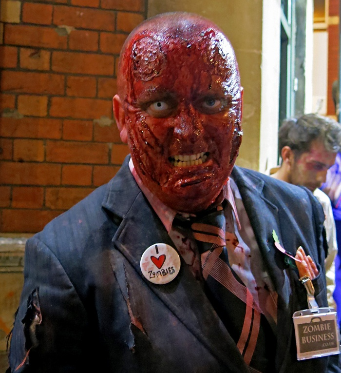 I Heart Zombies and Zombie Business - skinless businessman grins for camera