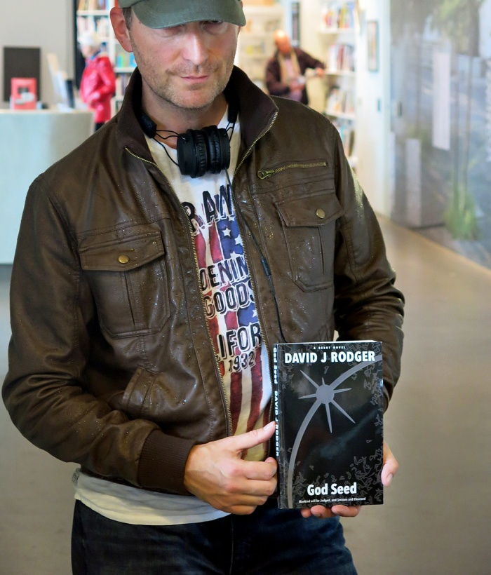 Sci-fi cyberpunk Dark Fantasy author David J Rodger with first printed copy of God Seed featuring new cover designed by The Sprezz October 2014
