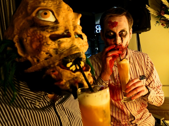 Thomas D Parker enjoys a zombie cocktail with some kind of weird-looking friend what IS that supposed to be