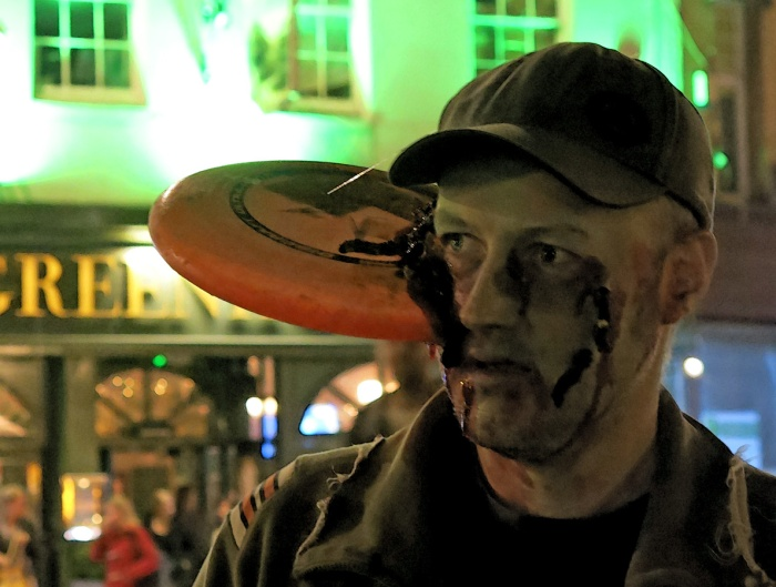 zombie with a frisbee embedded in his face