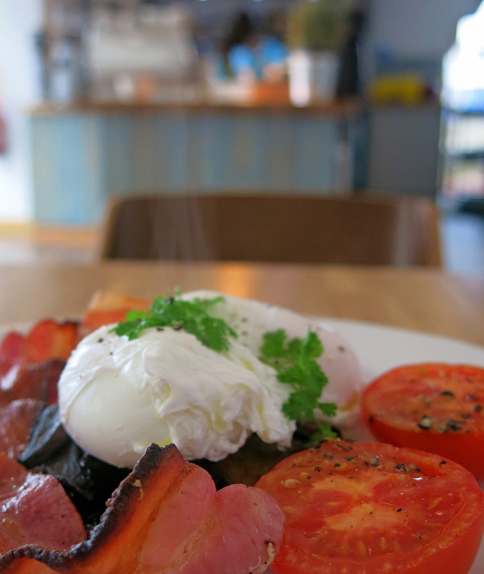 Best cooked breakfast in Bristol  top cafe Brigstow Lounge - image of poached eggs on mushrooms, grilled tomatos and bacon - photo David J Rodger