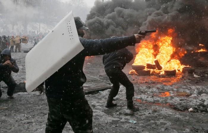 photos of fighting in Ukraine look post-apocalyptic - fighter with handgun from imgur dot com user magnacookies