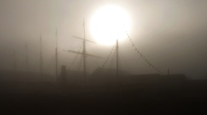 Fog shrouds Bristol Harbour eerie scene with tall ship masts and rigging photo by David J Rodger