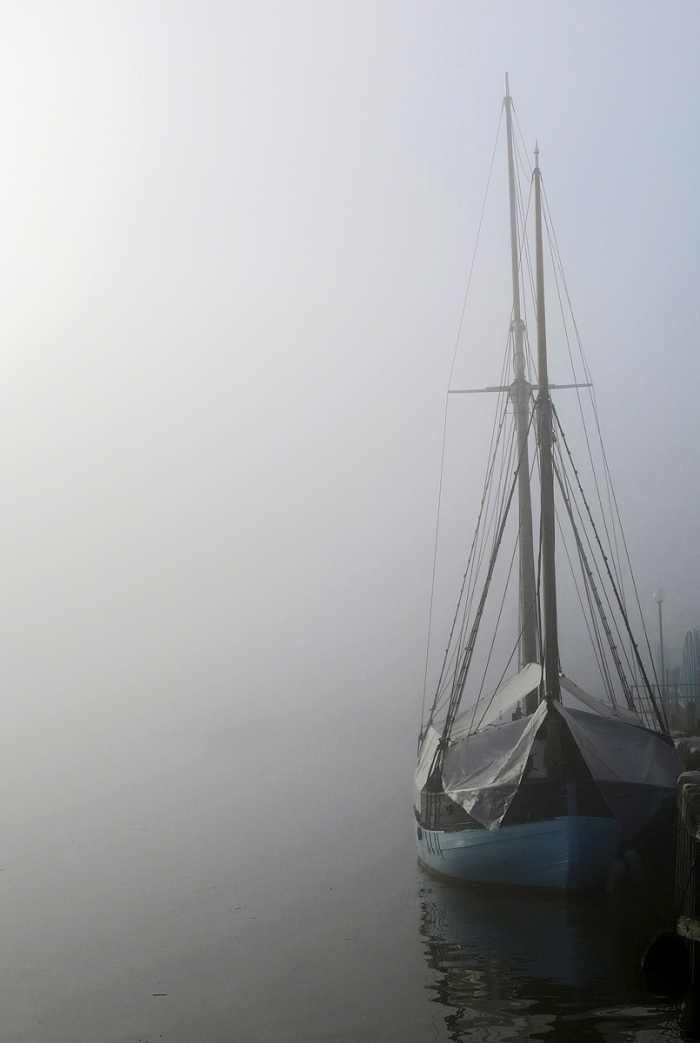 Small boat and masts emerging from fog Bristol Harbour photo by David J Rodger