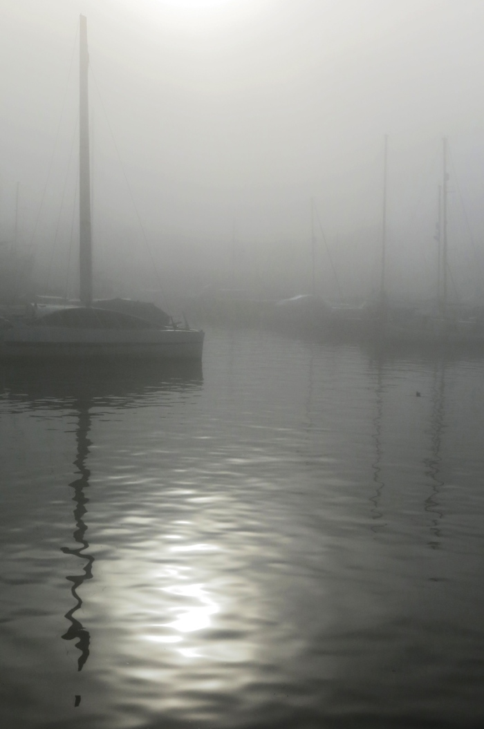 Sunlight through fog reflecting on water - Bristol Harbour photo by David J Rodger