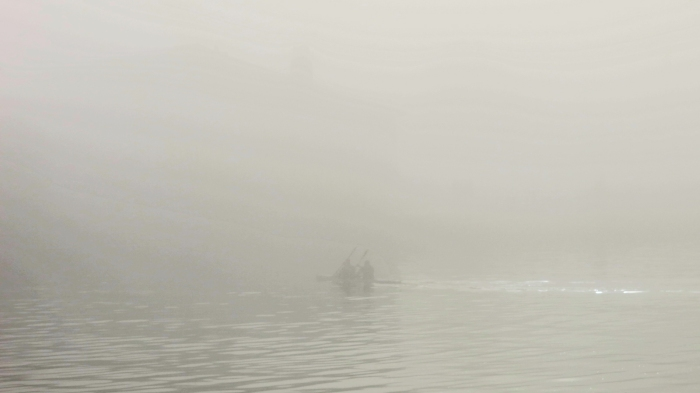 Two men paddle through dense thick fog Bristol Harbour photo by David J Rodger