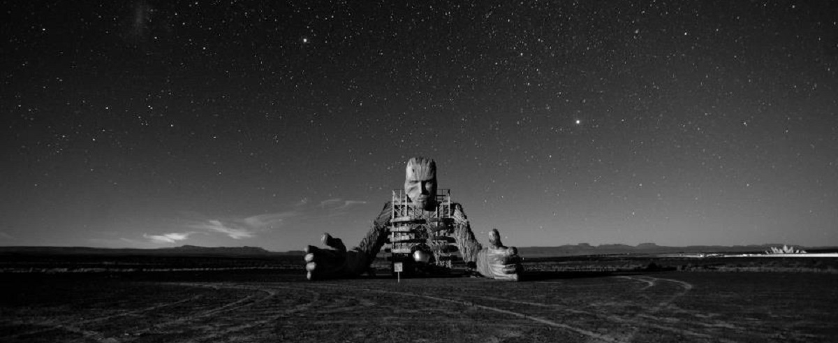 mysterious god like figure appears in post-apoocalypse wilderness like a Great Old One called to appear from Beyond The Void - daniel popper afrikaburn
