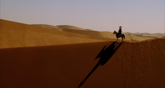 The Fall (2006) - lone figure cast upon the striking desert dune landscape - iconic style and hallmark of Tarsem Singh