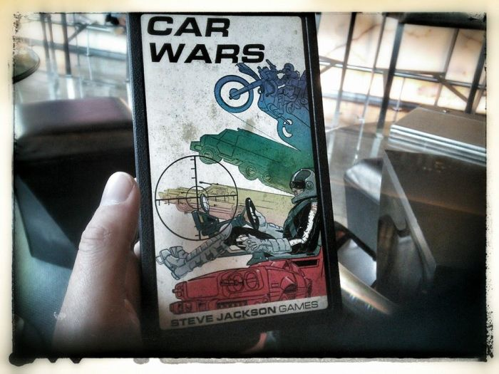 2015 and David J Rodger holds a copy of 1983 Car Wars by Steve Jackson Games