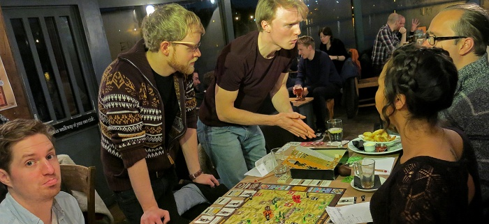 newbies get into board games in public places by playing Warrior Knights at the Grain Barge in Bristol - photo David J Rodger