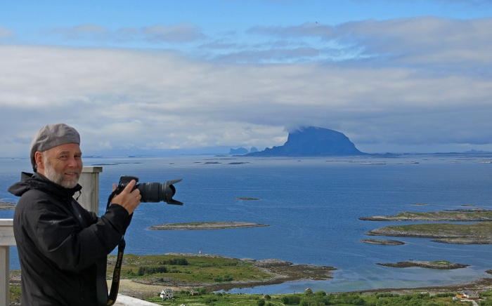 View from Donnesfjell of Lovund island - Kenn-Ole with camera - image by David J Rodger