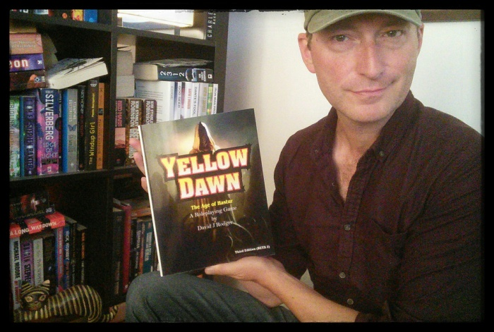 David J Rodger holding beta copy of 3rd edition Yellow Dawn The Age of Hastur not final cover