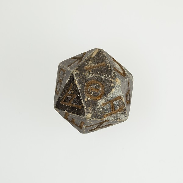 Twenty-sided die (icosahedron) with faces inscribed with Greek letters Ptolemaic Period–Roman Period 2nd century BC–4th century AD